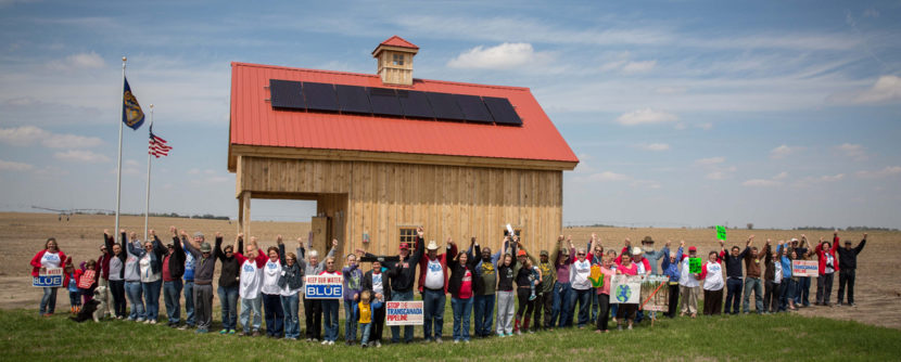 "Pipeline Fighters at the ""Build Our Energy"" solar-powered barn, paid for with online donations and built by volunteers on land directly in the path of the Keystone XL pipeline near Bradshaw, NE. (Photo: Mary Anne Andrei)"